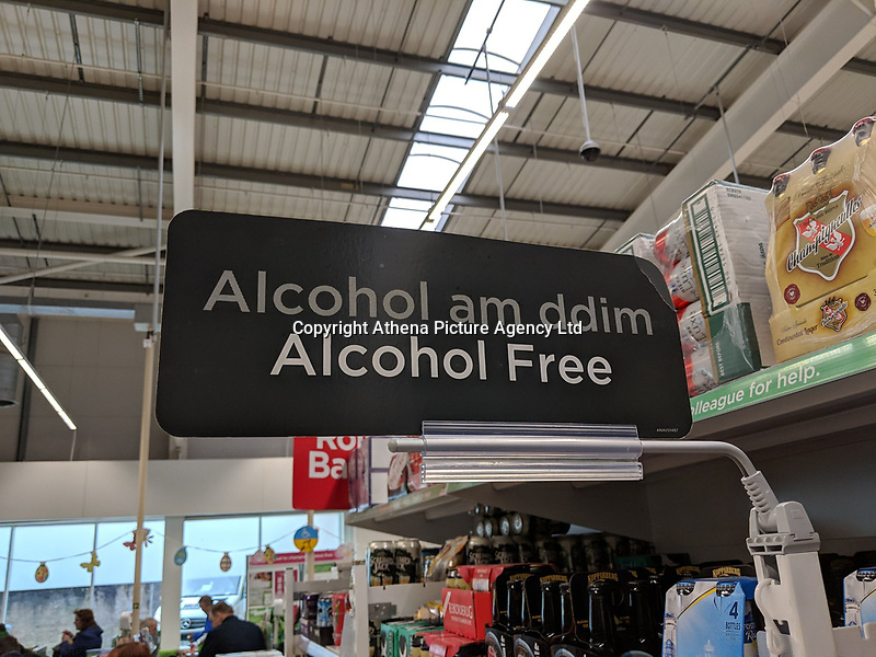 """Pictured: The """"Free Alcohol"""" sign in the ASDA store in Cwmbran, Wales, UK.<br /> Re: A sign in the Asda super market store in Cwmbran, Wales, for the alcohol-free section was incorrectly translated to """"free alcohol"""" in Welsh.<br /> Guto Aaron, who spotted the sign, wrote on Twitter: """"Get yourself to Asda, according to their dodgy Welsh translations they are giving away free alcohol.""""<br /> Asda have said it was changing the sign.<br /> The sign - which should read di-alcohol - in fact says alcohol am ddim, which means free alcohol.<br /> An Asda spokesman said: """"Mae'n ddrwg gennym (we are sorry). We would like to thank our eagle-eyed customers for spotting this mistake. We hold our hands up and will be changing the signs in our Cwmbran store straight away.""""<br /> The supermarket confirmed there would not be free alcohol in stores this weekend."""