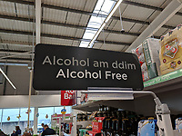 "2019 04 17 ""Free Alcohol"" sign in Welsh at Asda store in Cwmbran, Wales, UK"