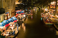Famous River Walk restaurants and cafes of Cafe Ole the Repiublic of Texas on water on holiday tourists in San Antonio Texas US