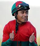 February 13, 2010. Martin Garcia, riding Jeranimo, gives the thumbs up sign after winning The Strub Stakes at Santa Anita Park, Arcadia, CA