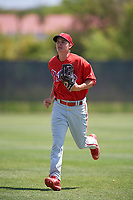 Philadelphia Phillies center fielder Mickey Moniak (15) jogs back to the dugout during a minor league Spring Training game against the Pittsburgh Pirates on March 24, 2017 at Carpenter Complex in Clearwater, Florida.  (Mike Janes/Four Seam Images)