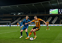 Hull City's Tom Eaves shields the ball from Grimsby Town's Ludvig Ohman<br /> <br /> Photographer Alex Dodd/CameraSport<br /> <br /> EFL Papa John's Trophy - Northern Section - Group H - Hull City v Grimsby Town - Tuesday 17th November 2020 - KCOM Stadium - Kingston upon Hull<br />  <br /> World Copyright © 2020 CameraSport. All rights reserved. 43 Linden Ave. Countesthorpe. Leicester. England. LE8 5PG - Tel: +44 (0) 116 277 4147 - admin@camerasport.com - www.camerasport.com