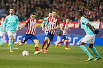 Atletico de Madrid's Koke Resurrecccion (L) and Saul Niguez and PSV Eindhoven's Jetro Willems during UEFA Champions League match. March 15,2016. (ALTERPHOTOS/Borja B.Hojas)