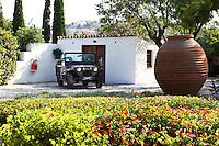 white traditional house with parked car