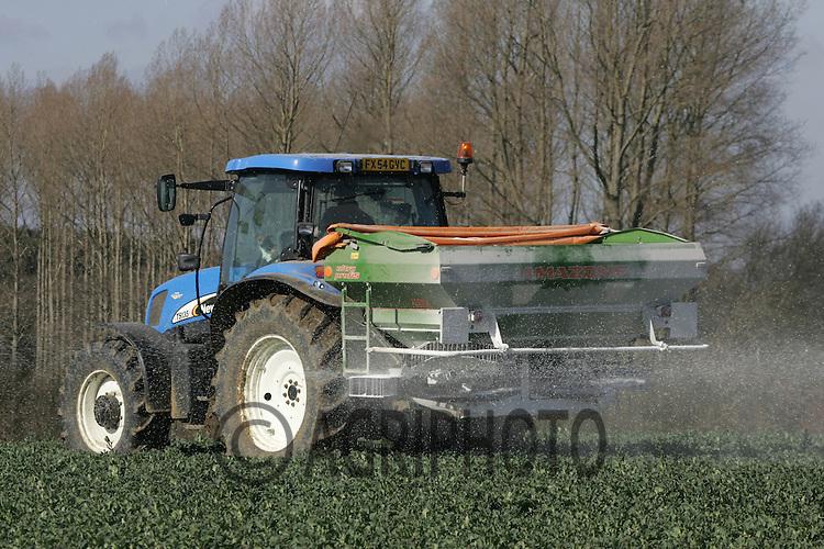 Farmer applying nitrogen to spring oil seed rape