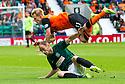 Dundee Utd's Gary Mackay-Steven is caught late by Hibs' David Gray.