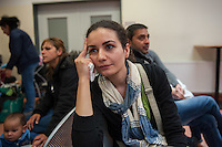 """Die """"Zentrale Aufnahmeeinrichtung des Landes Berlin fuer Asylbewerber"""" (ZAA) des Berliner Landesamt fuer Gesundheit und Soziales (LaGeSo) in der Turmstrasse 21 in Berlin-Moabit. Hier werden alle in Berlin ankommenden Fluechtlinge registriert und bekommen eine Erstversorgung. In dieser Erstaufnahmestelle werden sie auf die vom Land bereitgestellten Unterkuenfte verteilt.<br /> Im Bild: Vida Razavi aus dem Iran warten seit 5 Stunden.<br /> 24.9.2014, Berlin<br /> Copyright: Christian-Ditsch.de<br /> [Inhaltsveraendernde Manipulation des Fotos nur nach ausdruecklicher Genehmigung des Fotografen. Vereinbarungen ueber Abtretung von Persoenlichkeitsrechten/Model Release der abgebildeten Person/Personen liegen nicht vor. NO MODEL RELEASE! Don't publish without copyright Christian-Ditsch.de, Veroeffentlichung nur mit Fotografennennung, sowie gegen Honorar, MwSt. und Beleg. Konto: I N G - D i B a, IBAN DE58500105175400192269, BIC INGDDEFFXXX, Kontakt: post@christian-ditsch.de<br /> Urhebervermerk wird gemaess Paragraph 13 UHG verlangt.]"""