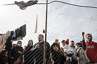 Pictured: Migrants by the fence of the camp Monday 06 February 2017<br /> Re: Scuffles between migrants and police broke out during a visit by Immigration Policy Minister Yiannis Mouzalas at the Elliniko migrant camp located in the former airport in the outskirts of Athens, Greece.
