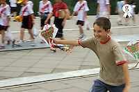 Boy (10) running with a chinese kite (Licence this image exclusively with Getty: http://www.gettyimages.com/detail/94466884 )