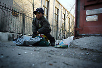 MONGOLIA. Ulaan Baatar. Huyga,6, collecting bottles and paper trash in order to sell to local recycling centres. As the global financial crisis grips Asia, Mongolia is feeling the implications first hand as the country suffers from rising inflation pushing the price of food and fuel ever upwards. For the country's homeless, who live in sewers and abandoned garages in the capital and already face extreme discrimination and are denied access to basic health and social care, their lives are hanging in the balance. 2008