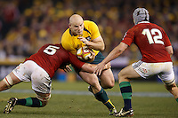 MELBOURNE, 29 JUNE 2013 - Stephen MOORE of the Wallabies is tackled by Geoff PARLING of the Lions during the Second Test match between the Australian Wallabies and the British & Irish Lions at Etihad Stadium on 29 June 2013 in Melbourne, Australia. (Photo Sydney Low / sydlow.com)