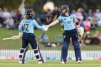 23rd February 2021, Christchurch, New Zealand;  Heather Knight (r) of England congratulates Tammy Beaumont of England on 50 runs during the 1st ODI Cricket match, New Zealand versus England, Hagley Oval, Christchurch, New Zealand