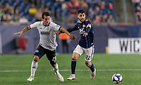 FOXBOROUGH, MA - JUNE 27: Ilsinho #25, Carles Gil #22 battle for the ball during a game between Philadelphia Union and New England Revolution at Gillette Stadium on June 27, 2019 in Foxborough, Massachusetts.