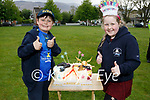 Adam and Grace Roche from Ashgrove, Tralee celebrating their 9th birthday as they receive a Birthday Salute from members of Tralee Garda and the Red Cross.