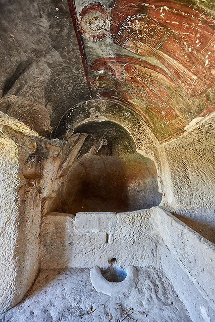 """Pictures & images of Koc Church frescoes, 10th century,  the Vadisi Monastery Valley, """"Manastır Vadisi"""",  of the Ihlara Valley, Guzelyurt , Aksaray Province, Turkey.<br /> <br /> The frescoes of Koc church depict two standing figures. One of them is an angel with a staff and a globe in eah hand. The other figure is a saint with an aura around the head. Both are richly clothed with ornaments decorated with pearls."""