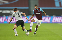 West Ham United's Sebastien Haller and Charlton Athletic's Ben Purrington<br /> <br /> Photographer Rob Newell/CameraSport<br /> <br /> Carabao Cup Second Round Northern Section - West Ham United v Charlton Athletic - Tuesday 15th September 2020 - London Stadium - London <br />  <br /> World Copyright © 2020 CameraSport. All rights reserved. 43 Linden Ave. Countesthorpe. Leicester. England. LE8 5PG - Tel: +44 (0) 116 277 4147 - admin@camerasport.com - www.camerasport.com