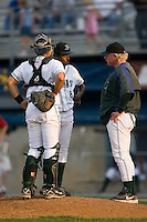 Princeton pitching coach Marty Demerritt (45) has a word with Tyree Hayes (8) and Mayo Acosta (11) during the first inning of play versus Johnson City at Hunnicutt Field in Princeton, WV, Friday, August 10, 2007.