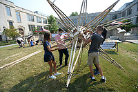 Paloma Rosso (from left) a ninth-grader at Thaden School, and Fernando Arreola, a senior at the University of Arkansas from Mexico, join Emery Brandt and Siena Fusco, both ninth-graders at Thaden School, as they construct a bamboo star Friday, Sept. 10, 2021, during the University of Arkansas Honors College Math Circus at Gearhart Hall on the university campus in Fayetteville. The event offered visitors a chance to build mathematical structures and to decorate with mathematical designs as a part of the larger celebration of the university's 150th birthday, Visit nwaonline.com/210911Daily/ for today's photo gallery.<br /> (NWA Democrat-Gazette/Andy Shupe)