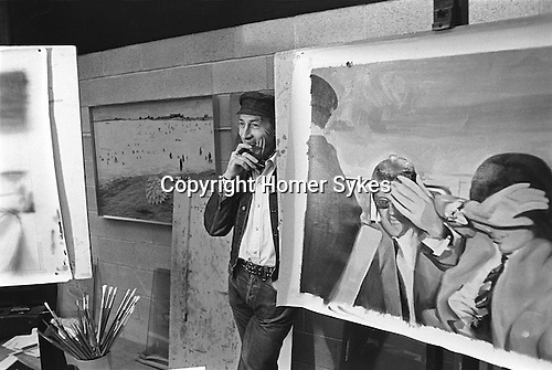 Richard Hamilton pop artist in his studio London UK 1968. Seen in studio with prints depicting Mick Jagger and Hamilton's art dealer Robert Fraser being arrested for possession of drugs. <br /> <br /> Swingeing London  1968-69<br /> Screen-print on canvas, acrylic and collage.