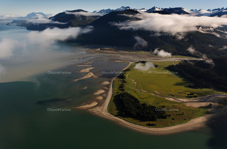 Estuaries are shrouded in morning fog in the direction of Lion's Head. Morning aerials of Tongass National Forest and eswaters flowing into the Lynn Canal in Alaska's Southeast.