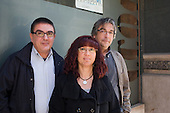 Salvador Slara and Joan Gasuli, of the health services section of the Commissiones Obreras trade union, with Hospitalet Home Care worker Rosa, Barcelona, Spain.