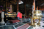 Bao-jhong Yi-min Temple, Kaohsiung -- Asking the gods for a blessing inside a Taiwanese temple.