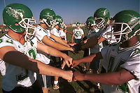 The Monroe football team huddles together in a pre-kickoff rally of team spirit during a practice Thursday afternoon.