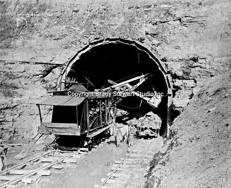Client:  Wabash Railroad<br /> Product: Barnhart's Railroad Ditcher<br /> Manufacturer: Marion Power Steam Shovel Company<br /> <br /> Hopedale OH:  View of the west end of the Spellacy Tunnel construction. Railroad steam shovel working on the entrance of the tunnel. The Pittsburgh, Toledo, and Western Railroad Company, owned by the famous George J. Gould,  hired Brady Stewart to document the track and tunnel construction between Hopedale Ohio, and downtown Pittsburgh.