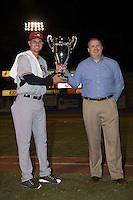 Hickory Crawdads manager Corey Ragsdale (24) accepts the Championship trophy from South Atlantic League President Eric Krupa after defeating the Asheville Tourists 5-1 to sweep the South Atlantic League Championship at McCormick Field on September 17, 2015 in Asheville, North Carolina. (Brian Westerholt/Four Seam Images)
