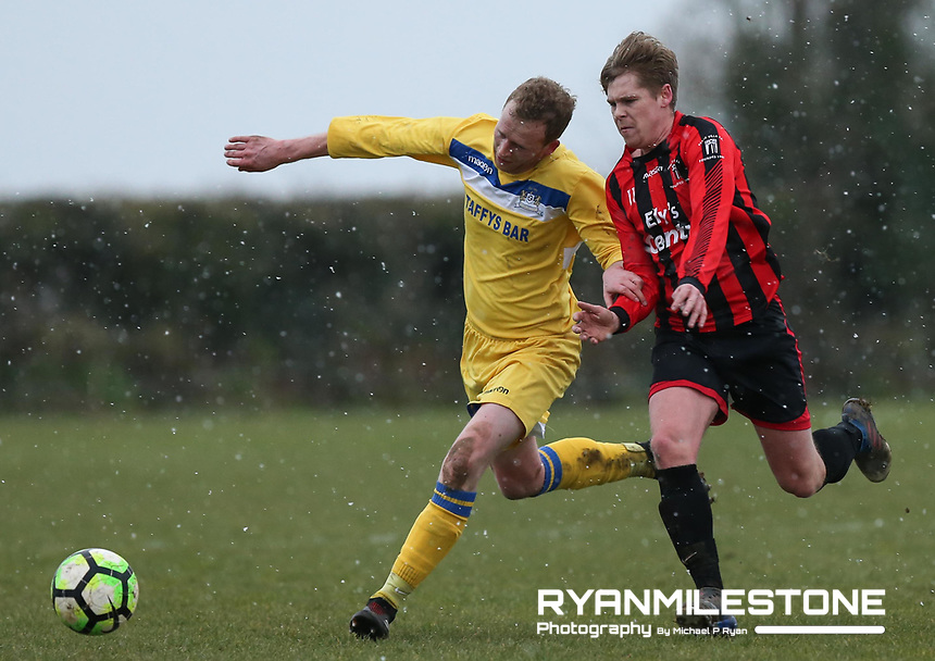Michael Byrne of Thurles in action against Peake Villa's Thomas Teer during the Munster Junior Cup 5th Round at Tower Grounds, Thurles, Co Tipperary on Sunday 11th February 2018, Photo By Michael P Ryan