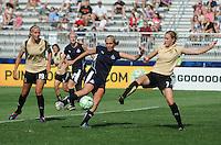 Washington Freedom forward Allie Long (9) against FC. Gold Pride midfielder Leigh Ann Robinson (7).   Washington Freedom defeated FC. Gold Pride 3-1at the Maryland SoccerPlex, Sunday May 31, 2009.