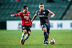 Joao Pereira of SC Kitchee (r) is chased by Muangthong United Midfielder Chanathip Songkrasin (l) during the 2017 Lunar New Year Cup match between SC Kitchee (HKG) vs Muangthong United (THA) on January 28, 2017 in Hong Kong, Hong Kong. Photo by Marcio Rodrigo Machado/Power Sport Images