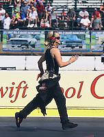 Aug. 3, 2014; Kent, WA, USA; Top fuel driver Jenna Haddock backs up her husband, NHRA funny car driver Terry Haddock back after his burnout  during the Northwest Nationals at Pacific Raceways. Mandatory Credit: Mark J. Rebilas-