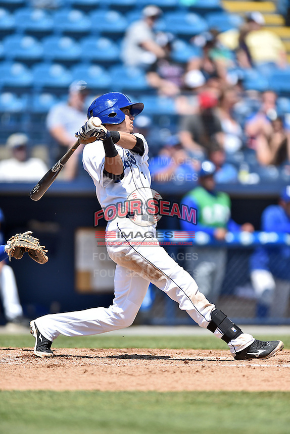 Asheville Tourists shortstop Emerson Jimenez (14) swings at a pitch during a game against the Lexington Legends on May 3, 2015 in Asheville, North Carolina. The Legends defeated the Tourists 6-3. (Tony Farlow/Four Seam Images)