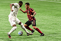 ATLANTA, GA - SEPTEMBER 02: Ezequiel Barco #8 of Atlanta United FC dribbles the ball during a game between Inter Miami CF and Atlanta United FC at Mercedes-Benz Stadium on September 02, 2020 in Atlanta, Georgia.