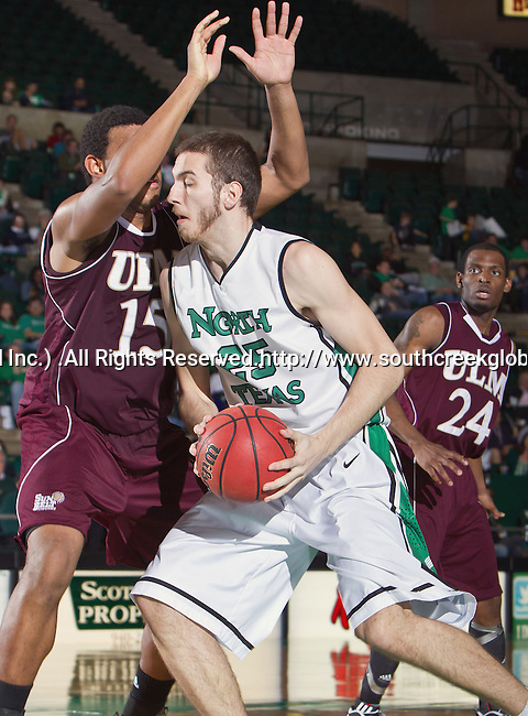 North Texas Mean Green forward Niko Stojiljkovic (25) and Louisiana Monroe Warhawks center Steven McClellan (15) in action during the game between the Louisiana Monroe Warhawks and the University of North Texas Mean Green at the North Texas Coliseum,the Super Pit, in Denton, Texas. UNT defeats ULM 86 to 51...