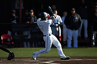 John Michael Faile (13) of the North Greenville Crusaders follows through on his swing against the Bellarmine Knights at Ashmore Park on February 7, 2020 in Tigerville, South Carolina. The Crusaders defeated the Knights 10-2. (Brian Westerholt/Four Seam Images)