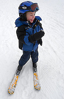 A young boy on skis at Sugar Mountain Ski Resort in NC.
