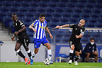 22nd April 2021; Dragao Stadium, Porto, Portugal; Portuguese Championship 2020/2021, FC Porto versus Vitoria de Guimaraes; Jesus Corona of FC Porto breaks past Gideon Mensah and André André of Vitoria de Guimaraes