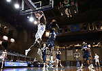 SIOUX FALLS, SD - MARCH 8: Douglas Wilson #35 of the South Dakota State Jackrabbits dunks past defender DeShang Weaver #14 of the Oral Roberts Golden Eagles during the Summit League Basketball Tournament at the Sanford Pentagon in Sioux Falls, SD. (Photo by Richard Carlson/Inertia)