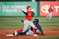 AZL Angels second baseman Livan Soto (2) makes a throw to first base over Yerry Landinez (27) during a rehab assignment in an Arizona League game against the AZL Padres 1 on July 16, 2019 at Tempe Diablo Stadium in Tempe, Arizona. The AZL Padres 1 defeated the AZL Angels 3-1. (Zachary Lucy/Four Seam Images)