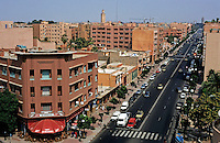 City buildings and the Mohamed V Avenue seen from a cafe, Marrakesh, Morocco.