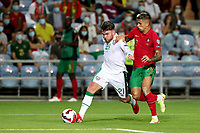 1st September 2021; Faro, Algarve, Portugal:  Irelands forward Aaron Connolly holds off Portugals defender Joao Cancelo during the FIFA World Cup,  2022 European qualifying round group A football match in Faro, Portugal