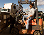 December 30, 2016. Rose Hill, North Carolina.<br /> <br /> John Dunn drives a forklift at Cottles Organics, a farm where he has worked since he was a child.<br />  <br /> John Dunn, age 19, is currently a freshman at NC State University and is the first person in his family to go to college. With a combination of grants, loans, help from his grandfather and weekend farm work, Dunn hopes to find finish college and find a career in agriculture.<br /> <br />  Colleges and universities, which are always trying to pinpoint an under-served and sometimes underprivileged populations of students, have noted a decline in students from rural areas of the country. There are various efforts underway in colleges and universities to identify more of these kids and get them enrolled.