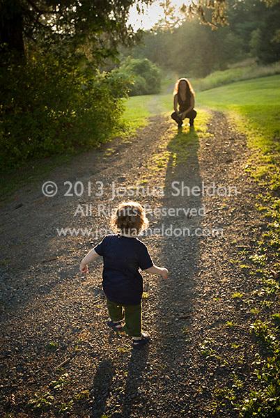 Small child running toward mother