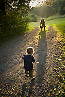 Small child running toward mother