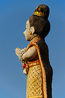 Wooden statue of a woman praying, Thailand, Asia.