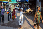 13 September, 2013, Ahmedabad, Gujarat INDIA :  Muslim boys in a market in Juhapura in Ahmedabad.  Juhapura was a small suburb with a small population until the mid 80s, but after the communal riots of Gujarat from 1985 until 2002, a large number of the Muslims migrated to Juhapura from the Muslim and Hindu-dominated areas of Ahmedabad.  Chief Minister of Gujarat , Narendra Modi has been announced as the Prime Ministerial candidate for the opposition BJP party in the Indian general elections slated for 2014.   Mr.Modi has been a controversial figure since his involvement in the 2002 Gujarat riots where a train full of Hindu pilgrims was attacked by Muslims returning from a disputed temple site in Ayodhya.  In retaliation some estimate up to 2000 Muslims lost their lives in communal violence.   Mr. Modi is alleged to have condoned the violence despite being cleared of any allegations by a Special Investigation Team (SIT) appointed by the Supreme Court of India. Picture by Graham Crouch/New York Times