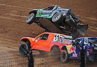Mar. 20, 2011; Chandler, AZ, USA;  LOORRS pro four driver Adrian Cenni (11) goes inside as Johnny Greaves goes up on two wheels in turn 1 during round two at Firebird International Raceway. Mandatory Credit: Mark J. Rebilas-