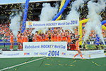 The Hague, Netherlands, June 14: Maartje Paumen #17 of The Netherlands holds up the World Cup Trophy during the winners ceremony after the field hockey gold medal match (Women) between Australia and The Netherlands on June 14, 2014 during the World Cup 2014 at Kyocera Stadium in The Hague, Netherlands. Final score 2-0 (2-0)  (Photo by Dirk Markgraf / www.265-images.com) *** Local caption ***